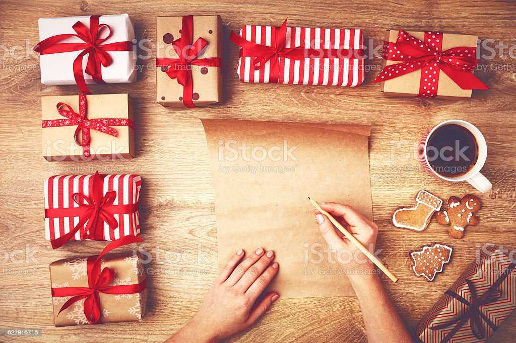 hand of  woman written list of wishes for Christmas stock photo