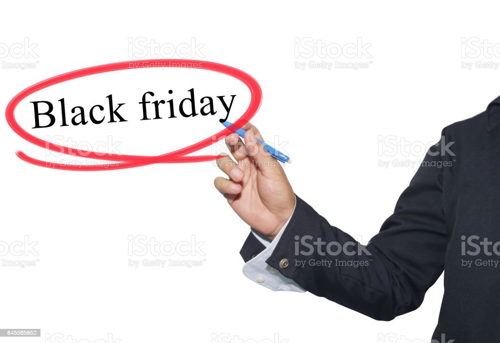 Hand of young businessman write the word Black Friday isolated on white background. stock photo