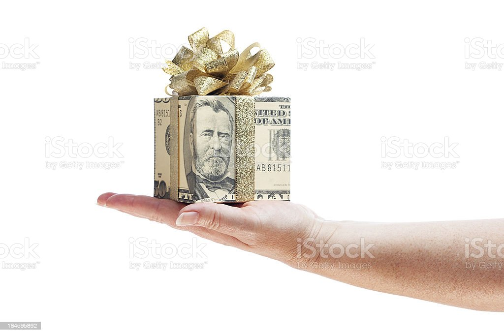 Hand Offering Gift of Money in Gold Ribbon on White royalty-free stock photo