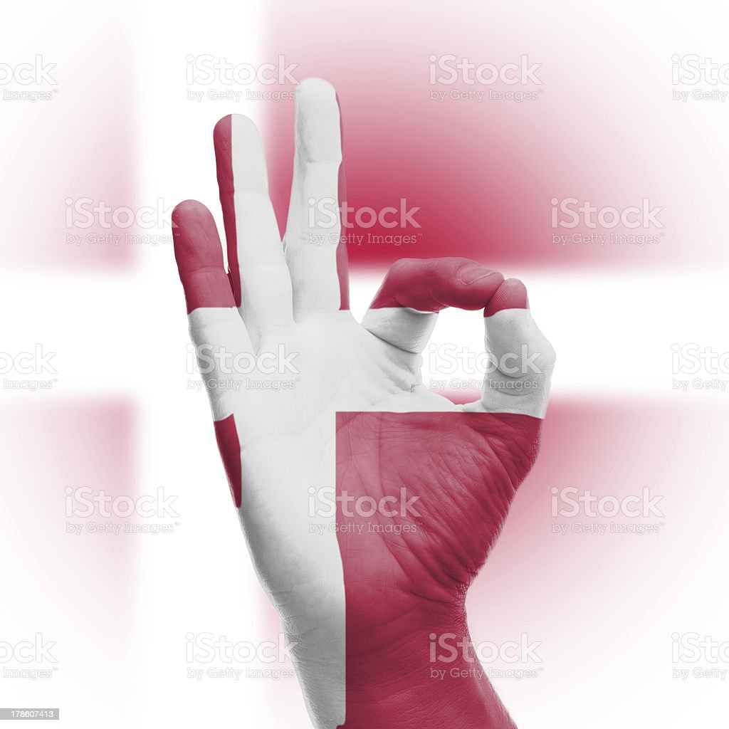 hand OK sign with Danish flag royalty-free stock photo