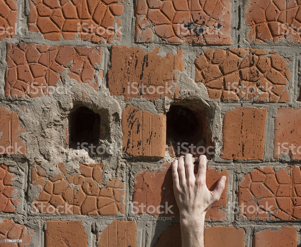 Hand on a brick wall royalty-free stock photo