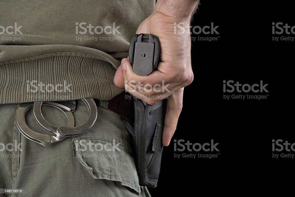 Hand on a gun royalty-free stock photo