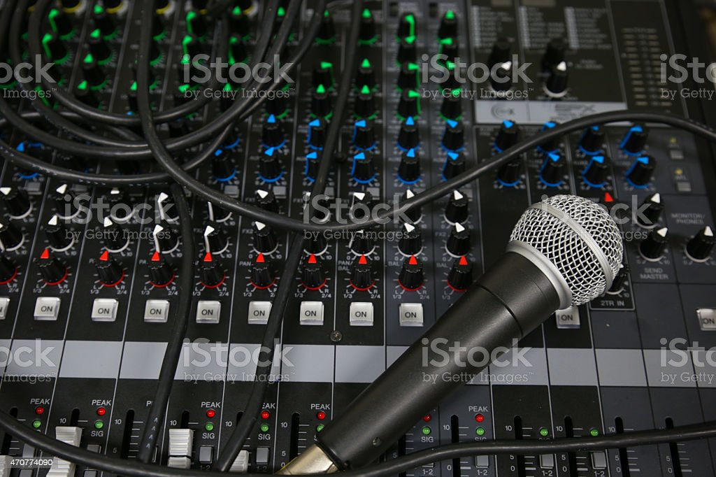 Hand on a Mixing Desk Fader in Television Gallery stock photo