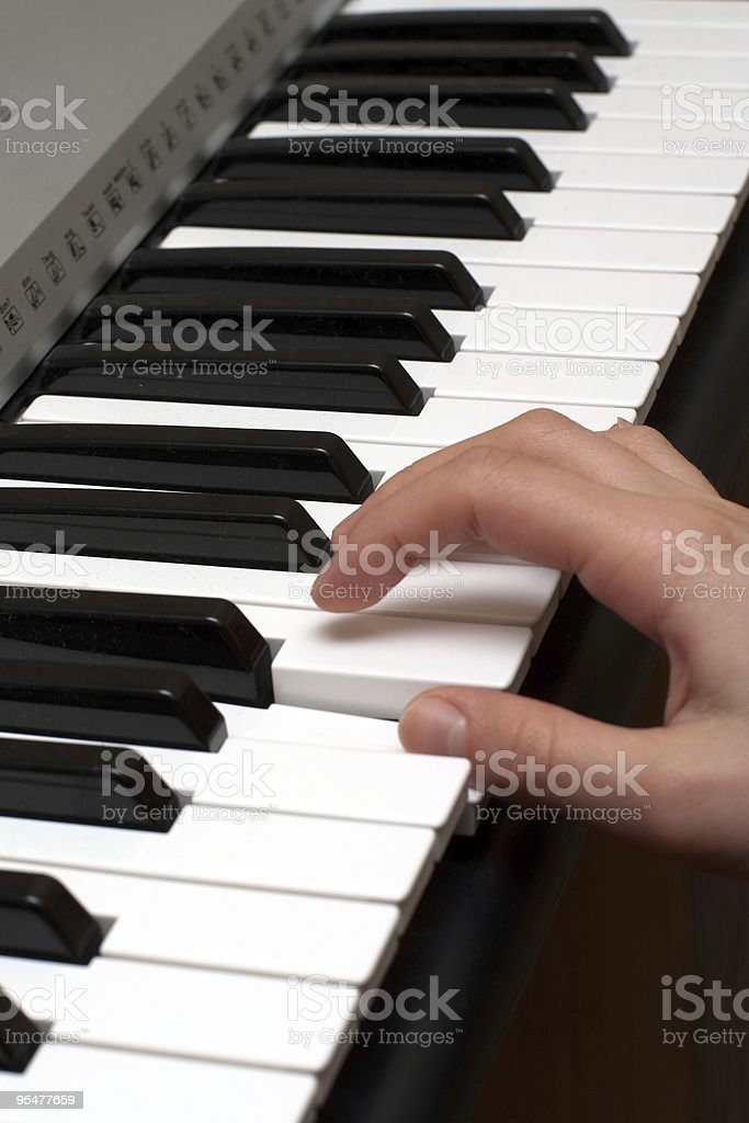 Hand on a piano royalty-free stock photo