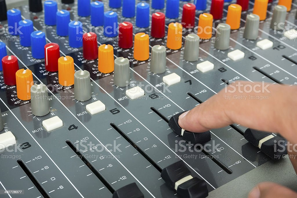 Hand on a sound mixer stock photo