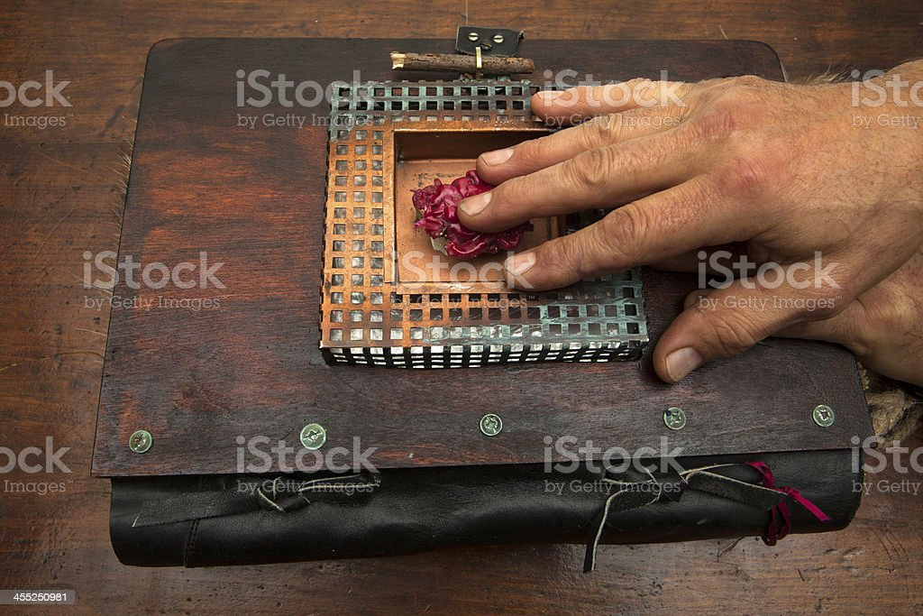 Hand on a strange book stock photo
