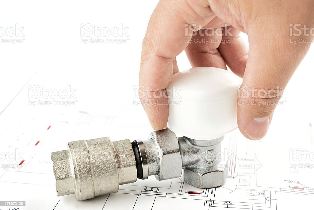 hand on a valve royalty-free stock photo