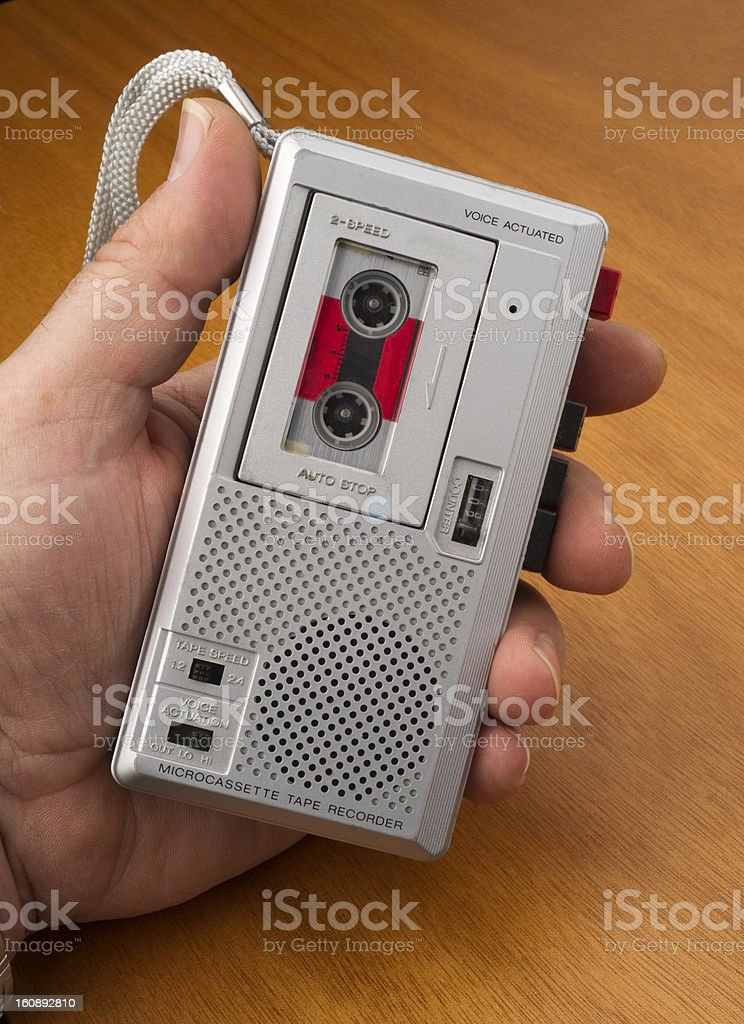 Hand on Audio Recorder using Tape the Old Fashioned Way stock photo