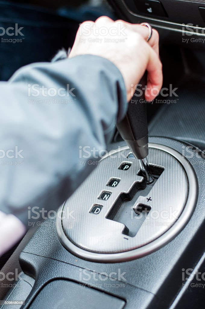 Hand on automatic gear shift stock photo