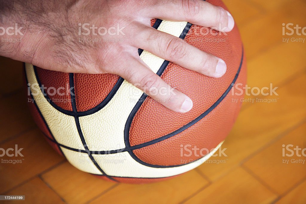 Hand on ball royalty-free stock photo