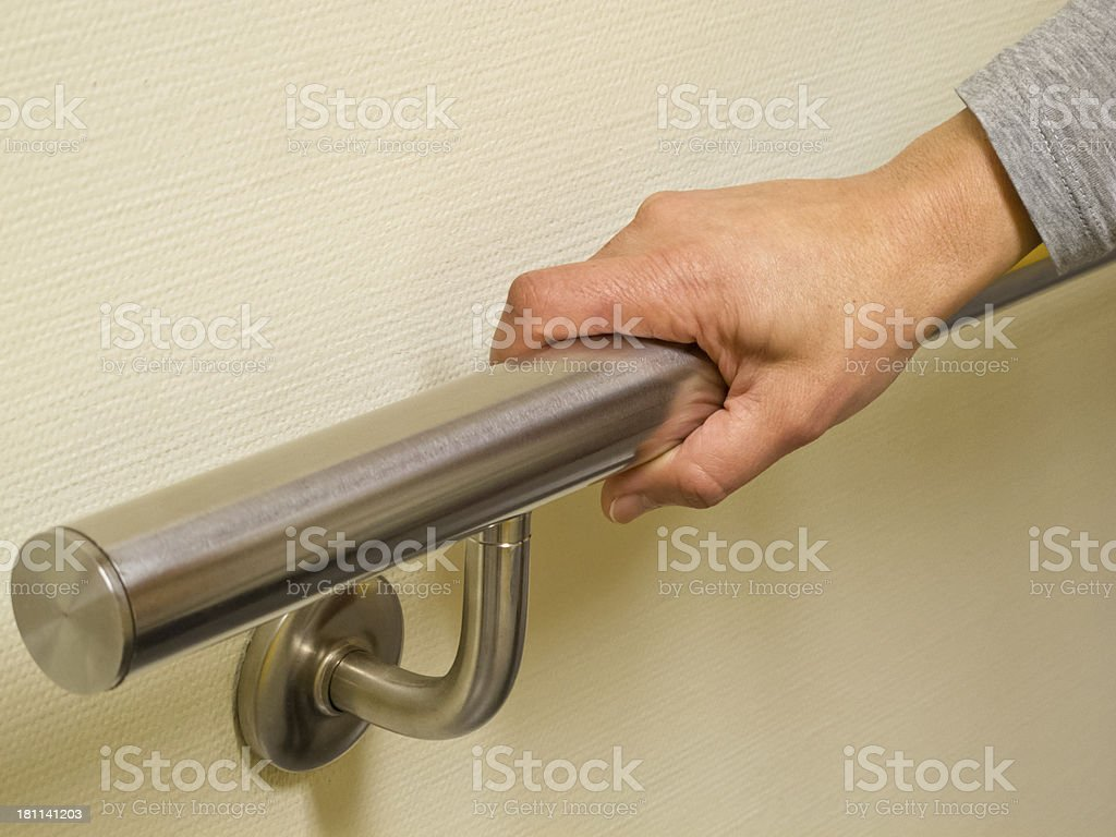 Hand on banister. stock photo