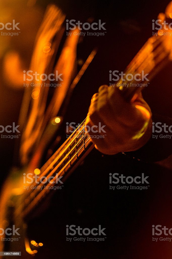 Hand on Bass guitar - on stage royalty-free stock photo