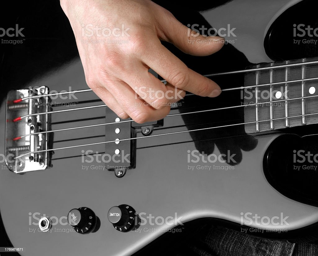 hand on bass guitar stock photo