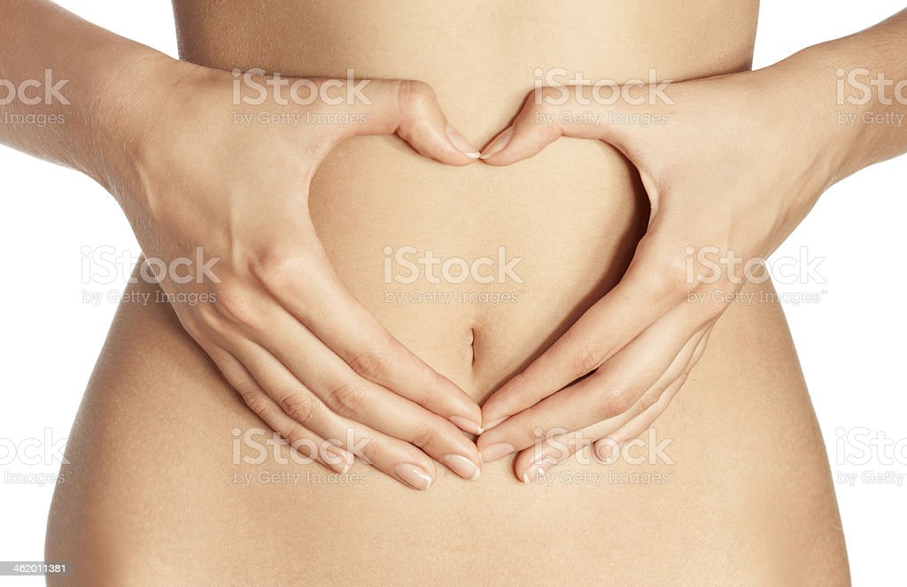Hand on belly isolated stock photo