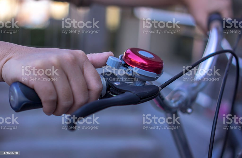 hand on bicycle bell and handlebar stock photo
