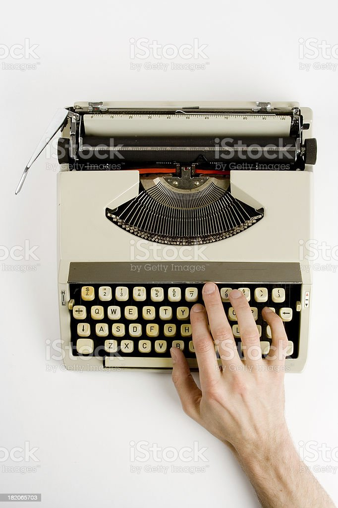 Hand on classic typewriter royalty-free stock photo