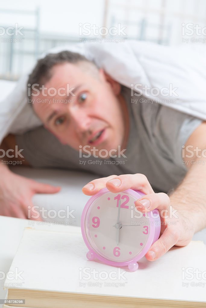Hand on clock stock photo