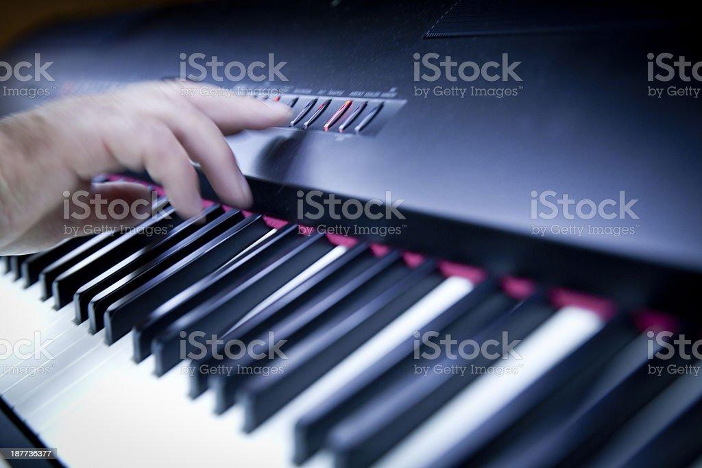 hand on digital piano royalty-free stock photo