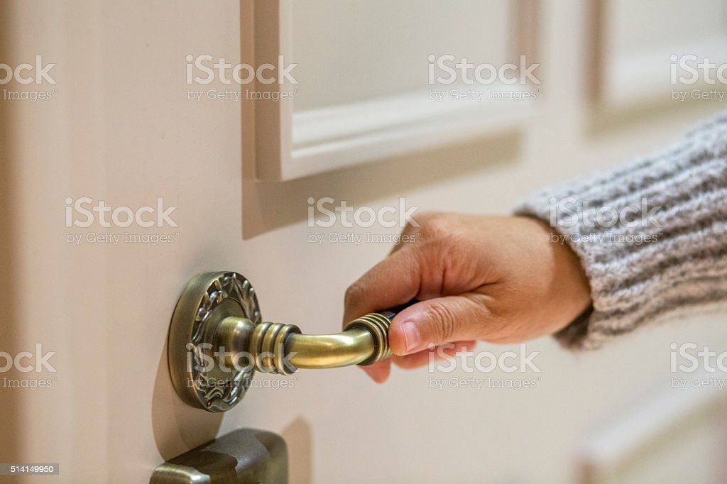 hand on door knob stock photo