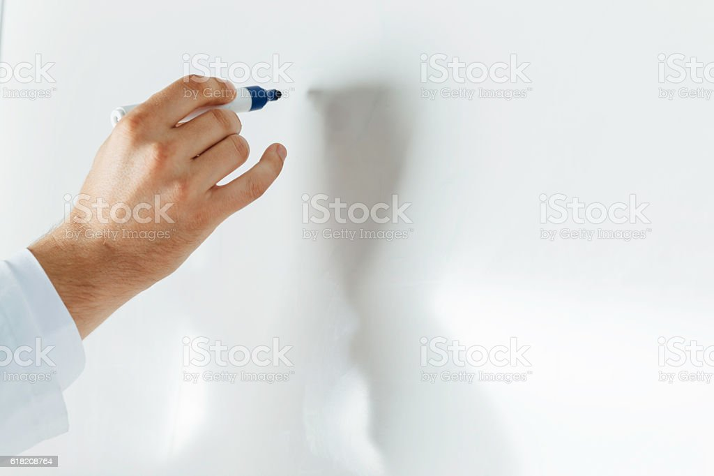 Hand on Empty whiteboard stock photo