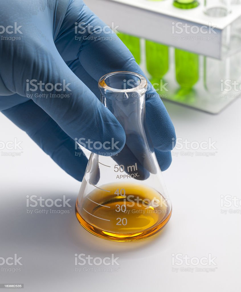 Hand on flask stock photo