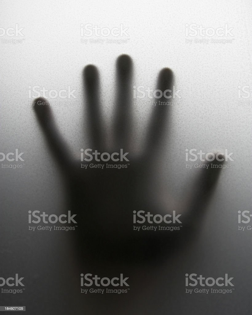 Hand on frosted glass stock photo