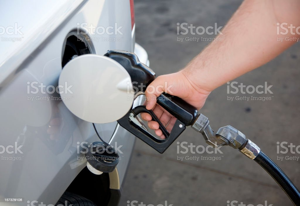 Hand on Gasoline Nozzle royalty-free stock photo