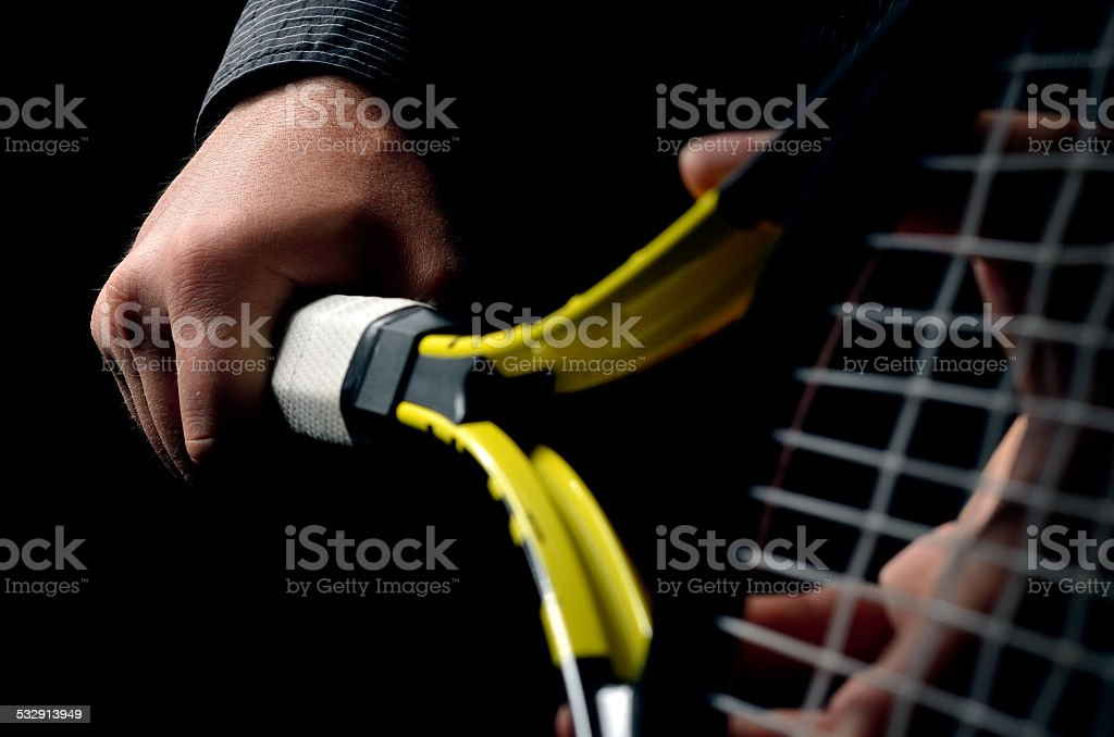 Hand on grip and swinging a tennis racket stock photo