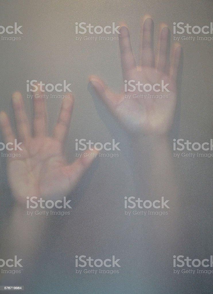 hand on Ground glass stock photo