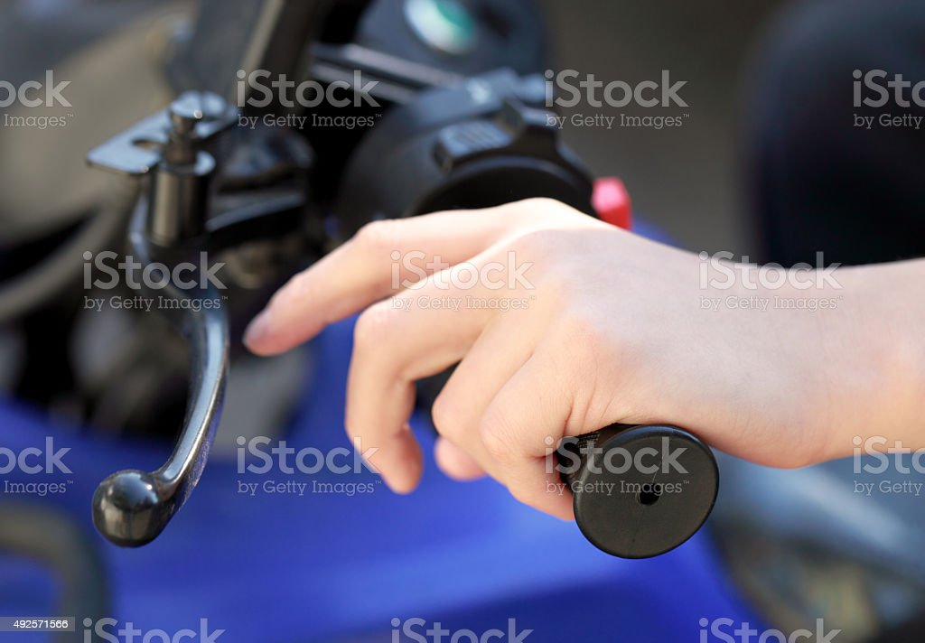 Hand on handle of a motorcycle. stock photo