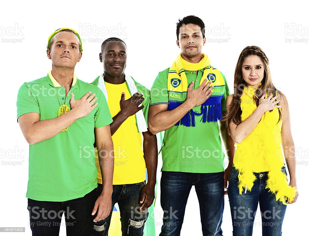 Hand on heart, four soccer fans support national team stock photo