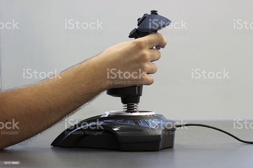 Hand on joystick royalty-free stock photo