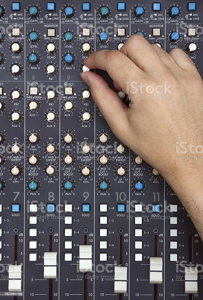 Hand on Mixing Desk royalty-free stock photo