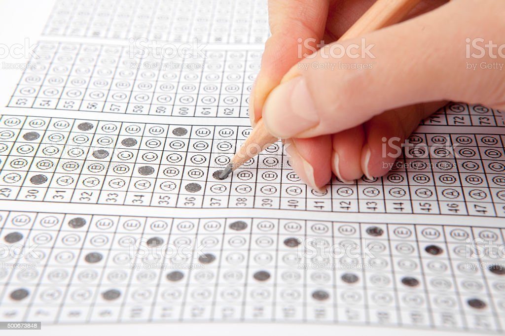 Hand on pencil choosing the test list on the examination stock photo