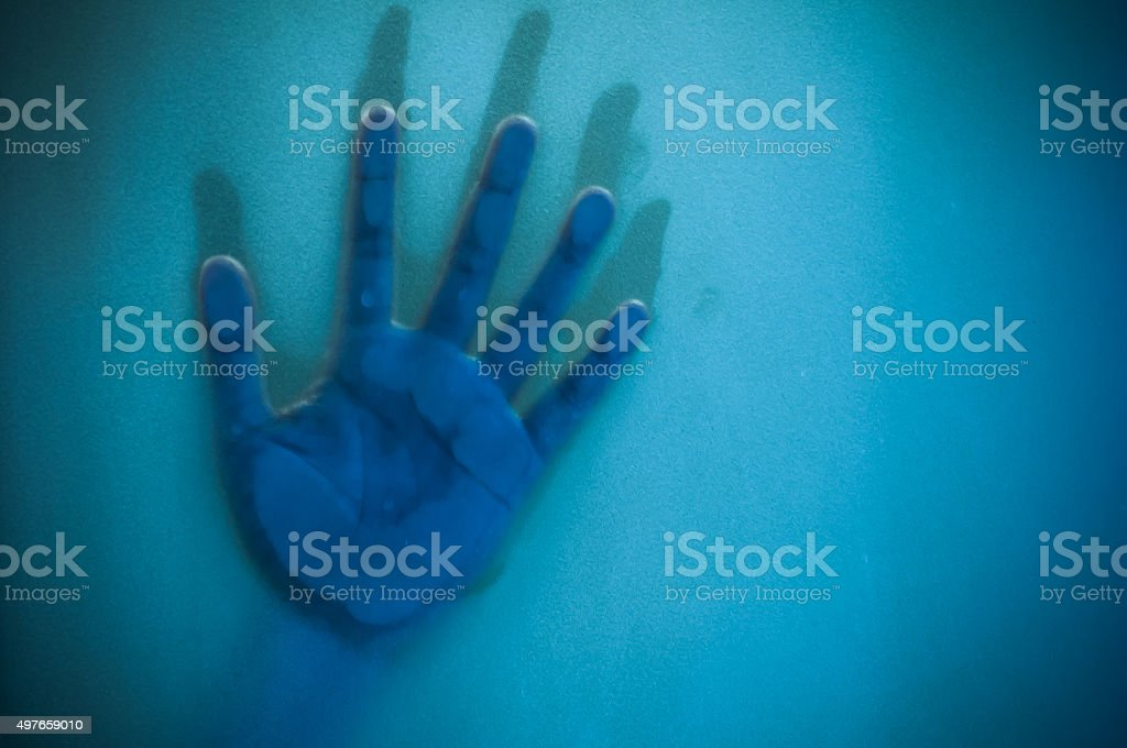 Hand on sandblasted glass stock photo
