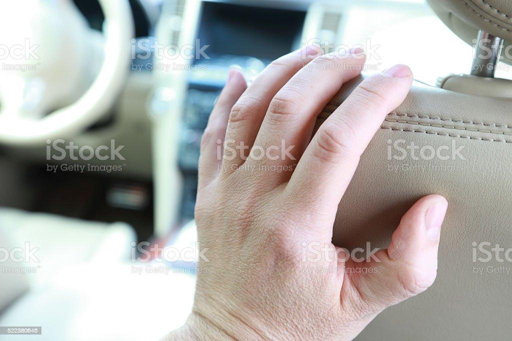 Hand on seat stock photo
