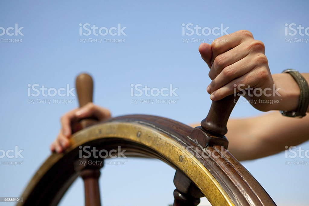 Hand on ship rudder. stock photo