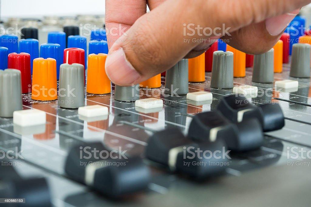 Hand on Soundboard - Stock Image stock photo