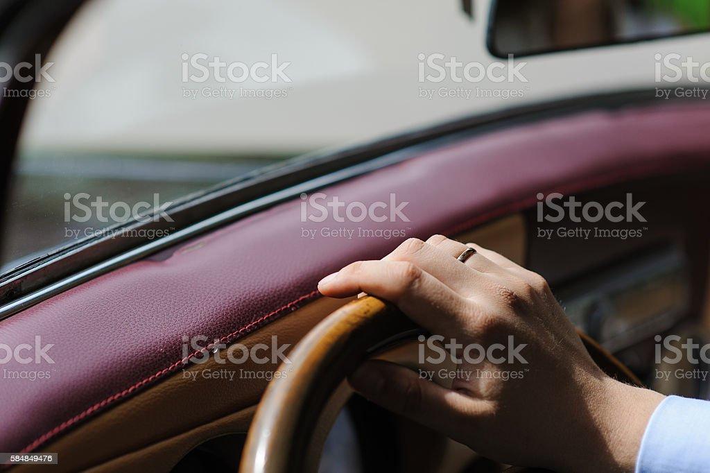 Hand on steering wheel of retro car stock photo
