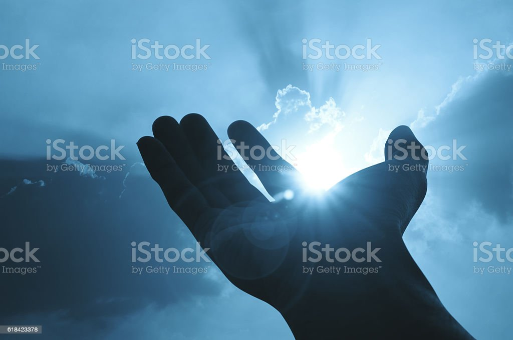 Hand on sunset background success, peace,freedom concept stock photo