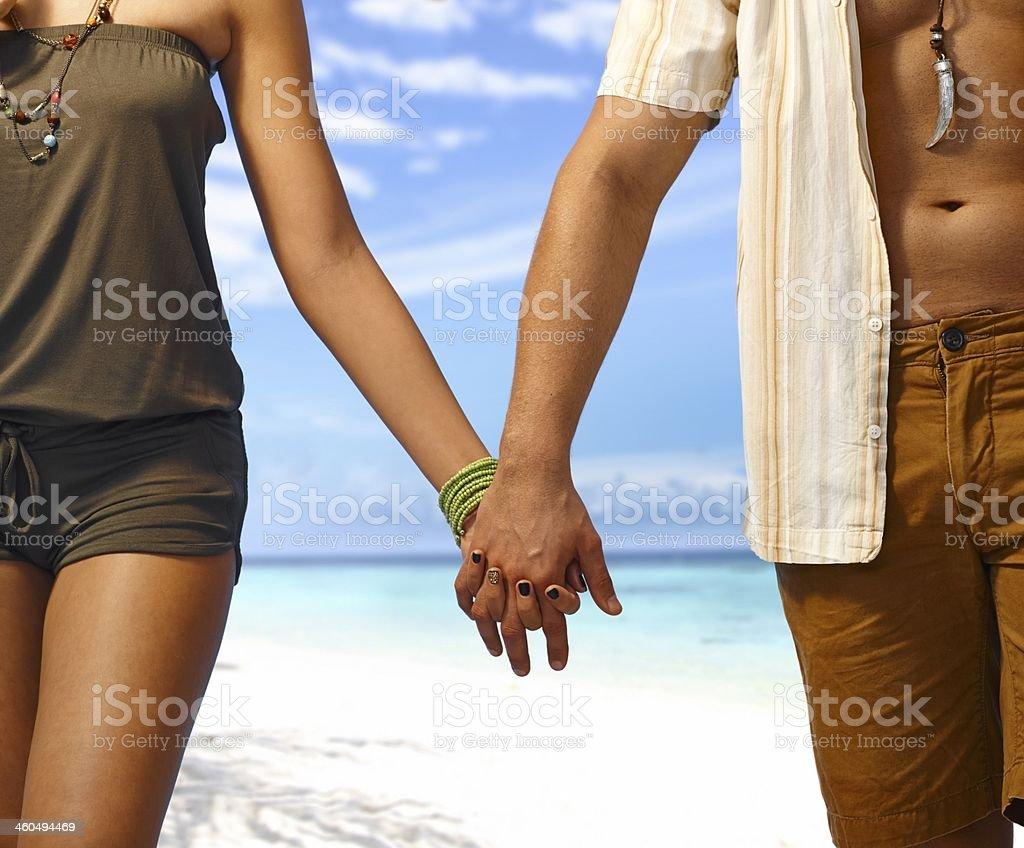 Hand on the beach stock photo