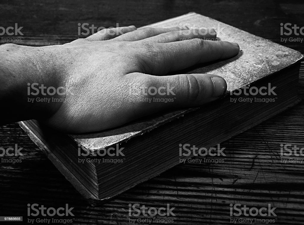 Hand on the old book royalty-free stock photo