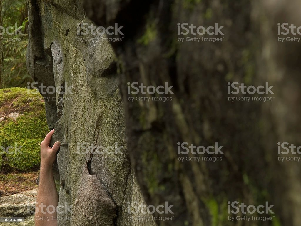 Hand on the rocks royalty-free stock photo