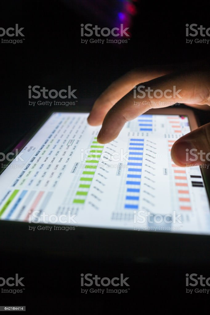 hand on touch pad with report stock photo