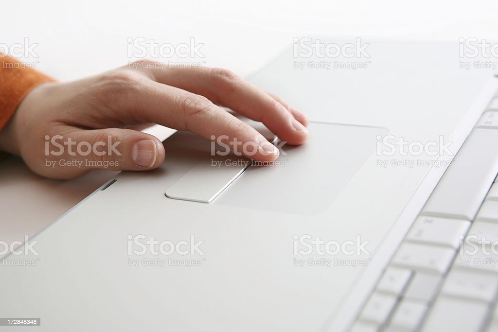 hand on touchpad royalty-free stock photo