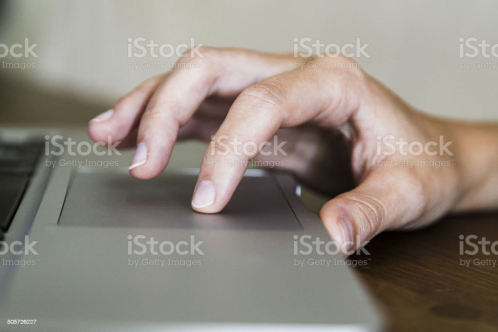 Hand on Trackpad stock photo