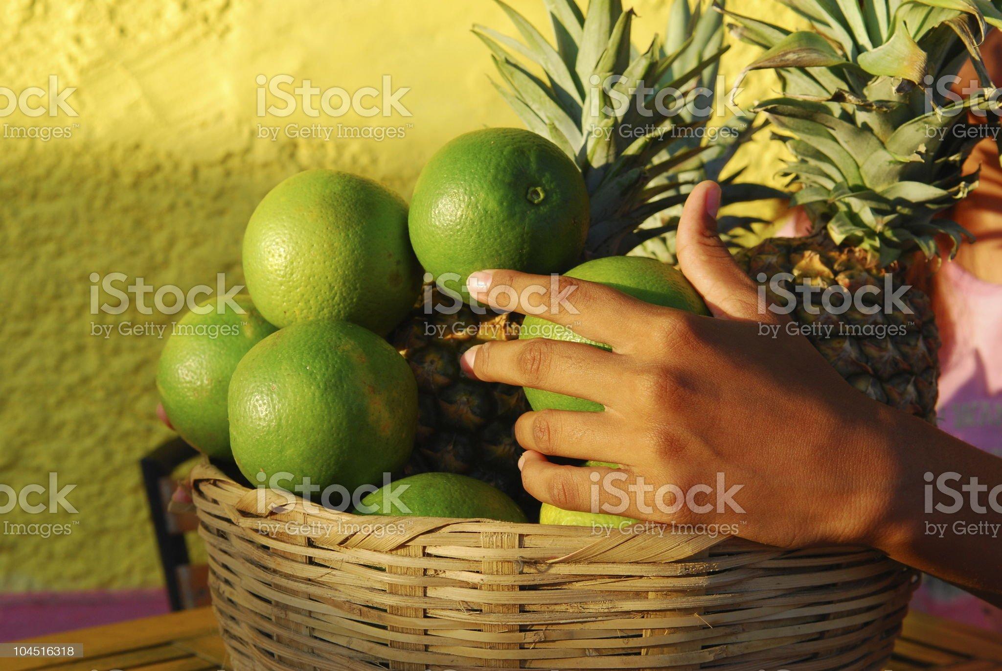 Hand on tropical fruit basket - Granada, Nicaragua royalty-free stock photo