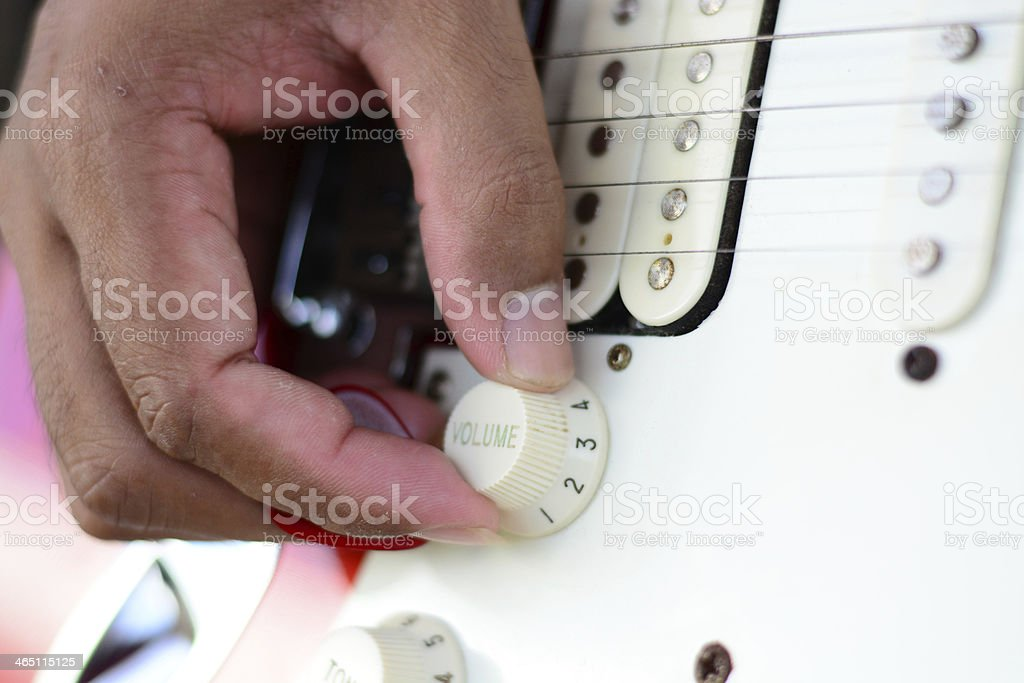hand on volume control stock photo
