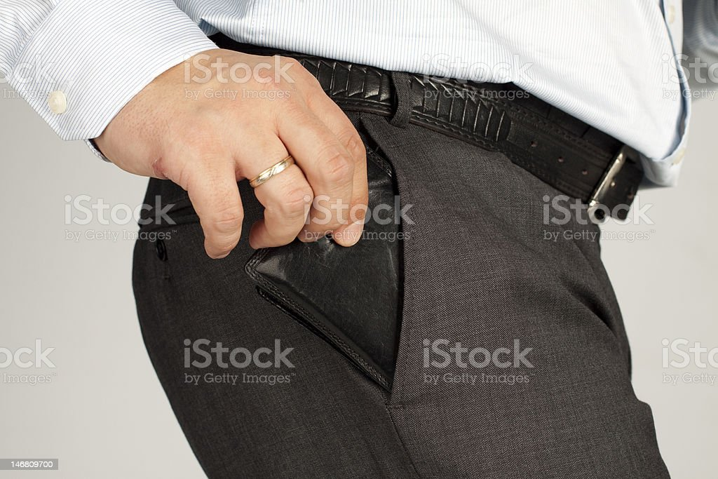 Hand on wallet royalty-free stock photo