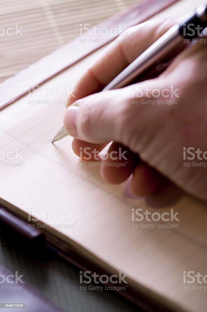 Hand on writing pad royalty-free stock photo